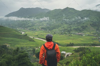 Young traveler standing and looking at view of nature
