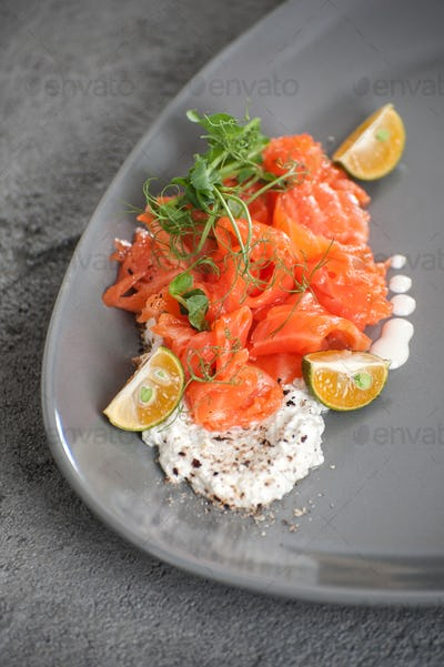 Salad from slightly salted salmon with cottage cheese cream and