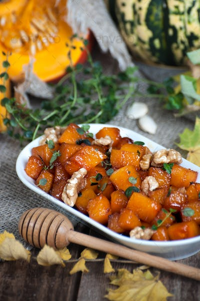 Pieces of caramelized pumpkin with honey, walnuts and thyme.