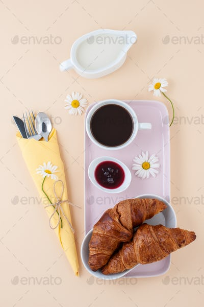 French breakfast: black coffee, milk and a croissant with jam se