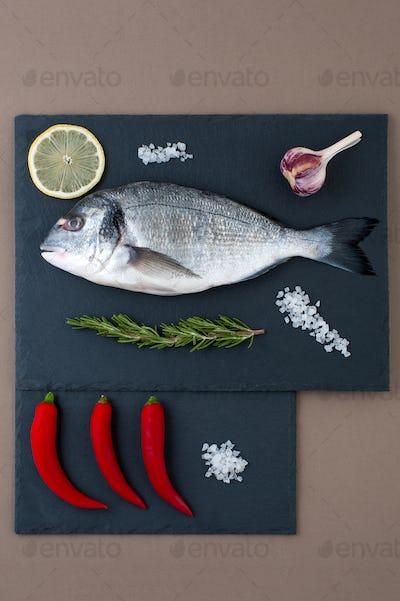 Fresh Dorado fish, chili pepper, garlic, lemon, rosemary and sal
