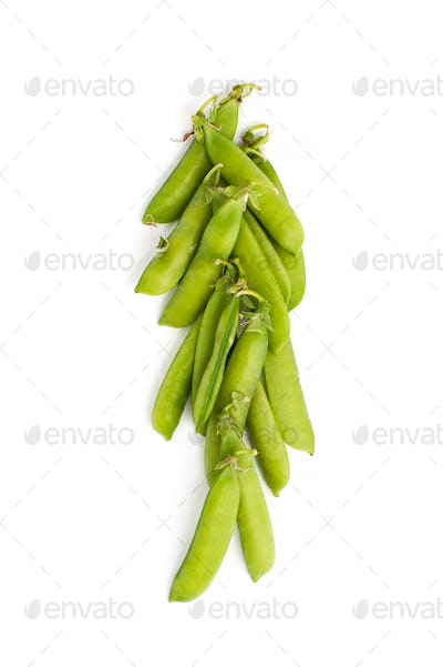 Young green stiletto peas on a white background.