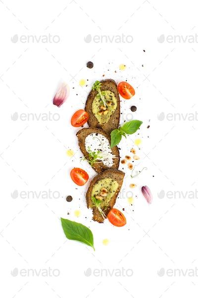 Three sandwiches with guacamole sauce, pesto and cream cream ser