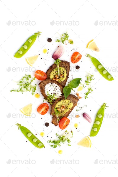 Three sandwiches with Pesto sauce and cream and young green peas