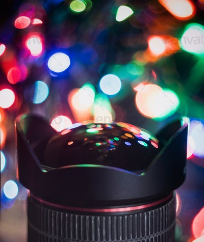 Christmas Light Reflection in a Camera Lens