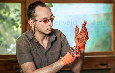 man wearing protective gloves