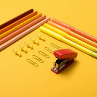 Colourful pencils over a yellow background