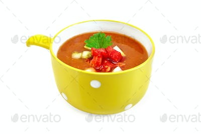 Soup tomato with parsley in yellow bowl