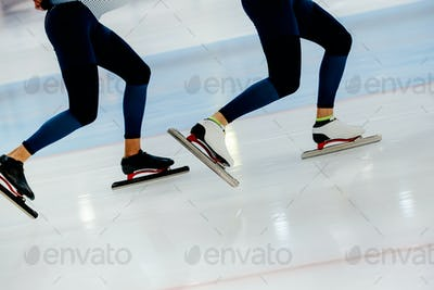 synchronous motion legs two athletes speed skaters