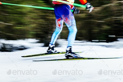 blurred image legs men skier