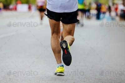 rear view legs male runner