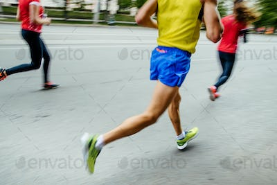 blurred motion group people runners