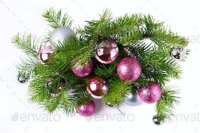 Christmas background with pink and silver balls door wreath