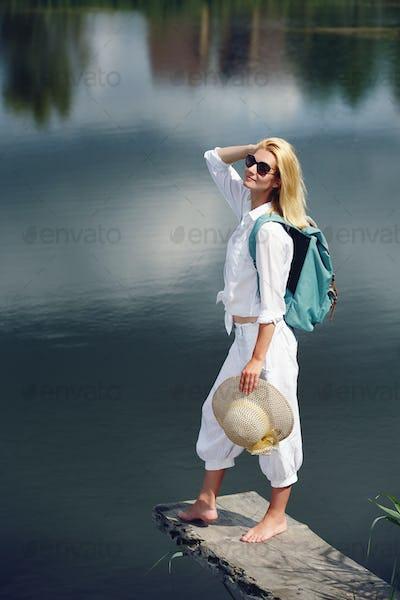 Young woman resting near lake