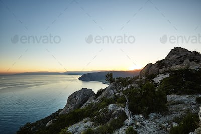Mountains and sea at sunset