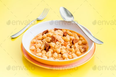 stewed chickpeas in modern dish on yellow table