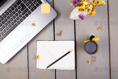 Notebook, coffee and flowers for female home or office workplace