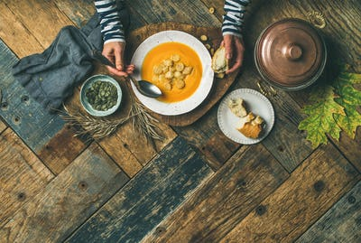 Fall warming pumpkin cream soup, copy space