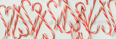 Christmas holiday candy cane pattern, texture and background, wide composition
