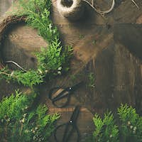 Preparing for Christmas, New Year. Flat-lay of wreaths, rope, scissors