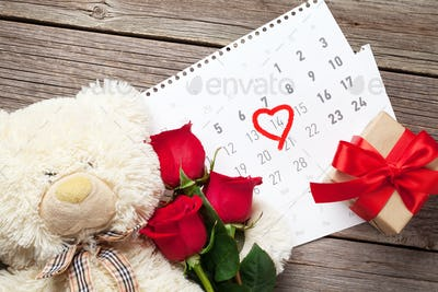 Red rose flowers, bear toy and coffee