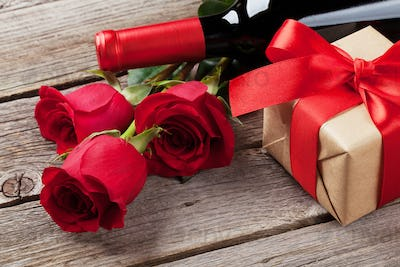 Red rose flowers, wine and gift box
