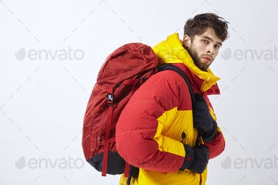 Mountaineer in winter clothes with hiking equipment on white isolated background
