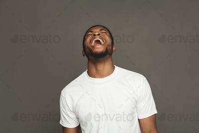 Facial expression, emotions, friendly black man laughing