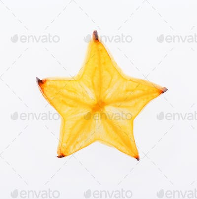 Yellow star fruit slice backlit, isolated on white