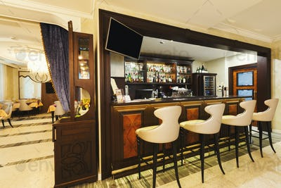 Hotel lounge bar with bottle shelfs and seats