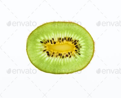Green kiwi slice backlit, isolated on white