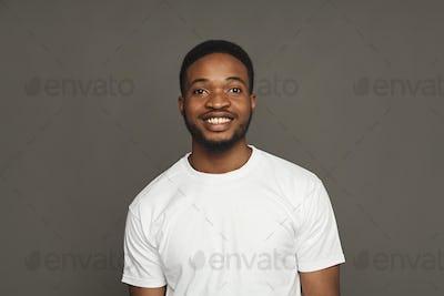 Facial expression, emotions, friendly black man smiling
