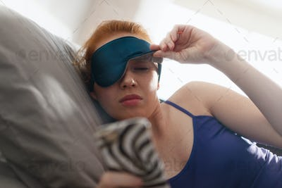 Woman In Bed Waking Up Snoozing Alarm Clock Mobile Phone
