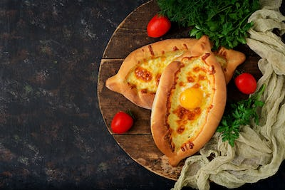 Khachapuri in Adjarian. Open pie with mozzarella and egg. Georgian cuisine.