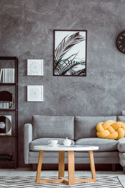 Painting above grey settee