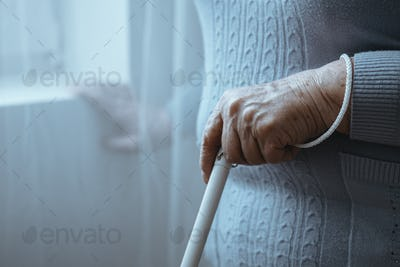 Blind person holding white cane