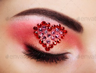 Eye make-up girl with a heart