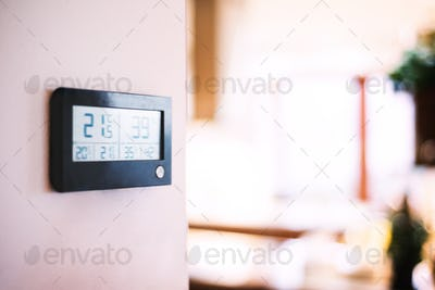 A meteostation on the wall.