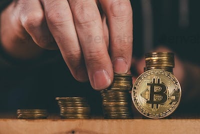 Bitcoin cryptocurrency miner stacking BTC coins