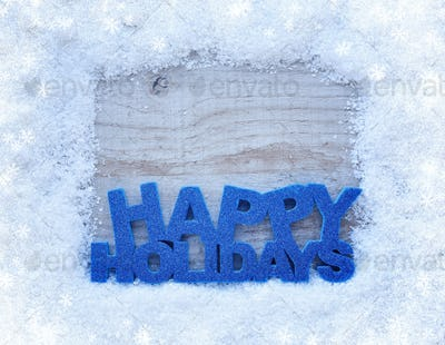 """The frame of the snow and the inscription """"Happy Holidays"""" on a"""
