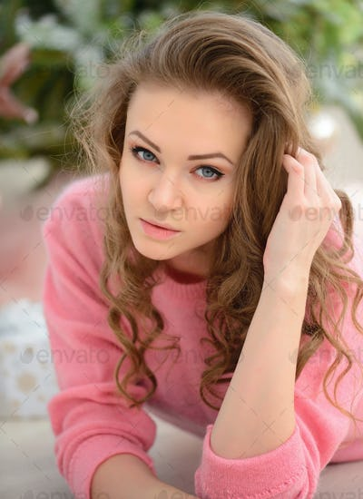 Beautiful young woman near the Christmas tree. New year concept.
