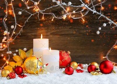 Christmas candles with Christmas ornaments and Christmas lights.