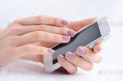 Women's hands holding mobile phone, hand touching phone screen