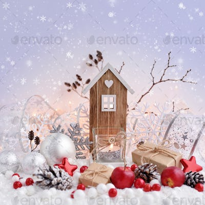 Christmas decorations with decorative balls, toy house and candl