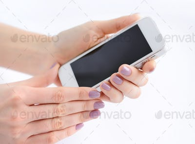 Women's hands holding mobile phone