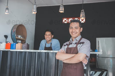 cafe owner standing with crossed arms