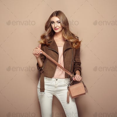 Young blond woman in brown jacket