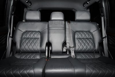 Black perforated leather back seats in modern luxury car