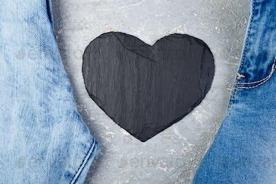 Denim. Jeans texture background. Valentine Day. Black Stone Slate heart. Copy space.