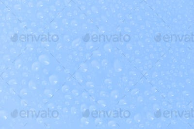 Drops of water on a blue background as a background
